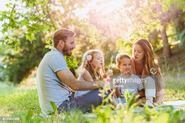 Young happy family spending time in nature
