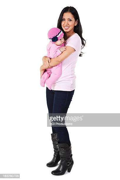 Junge glückliche Mutter hält Ihr Baby