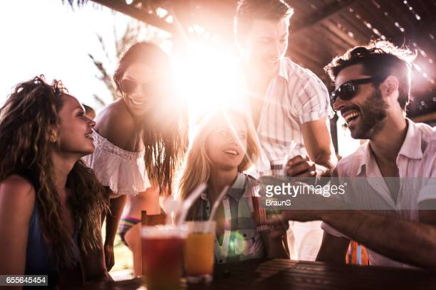 Young happy people enjoying a day in a bar.