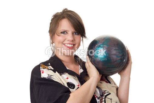 Young happy woman holding a bowling ball : Stock Photo