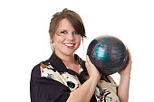 Young happy woman holding a bowling ball and wearing a bowling shirt; isolated on a white background