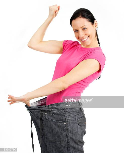 Young happy woman losing weight