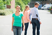 Woman Shouting At Her Boyfriend Looking At Woman Walking On Street