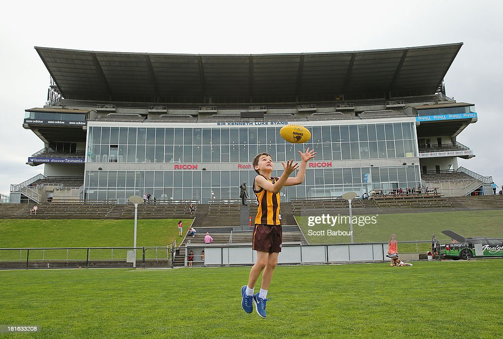 A young Hawks supporter plays footy on Waverley Park on September 23, 2013 in Melbourne, Australia. The Hawthorn Hawks play the Fremantle Dockers this Saturday in this year's 2013 AFL Grand Final.