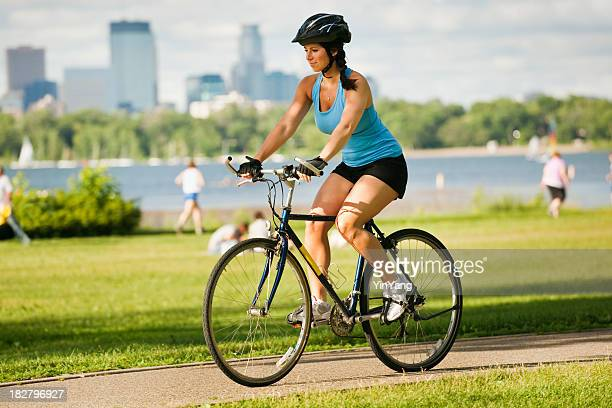 Young Healthy Woman Exercising on Bicycle in Urban City