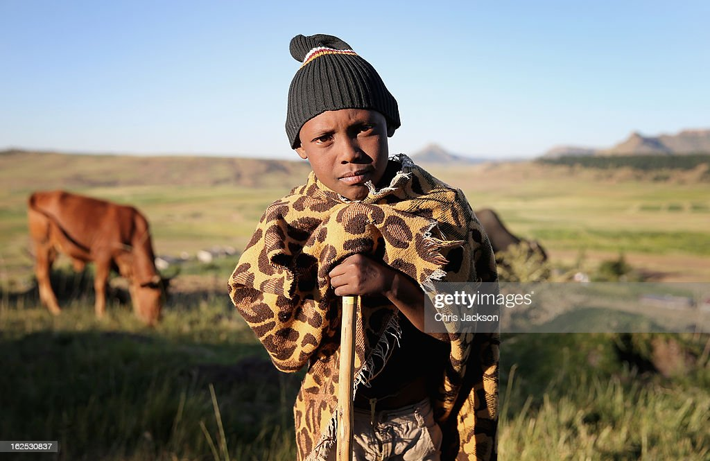 A young herd boy looks on during an outreach visit by charity workers from Sentebale on February 23, 2013 in Morija, Lesotho. Sentebale is a charity founded by Prince Harry and Prince Seeiso of Lesotho. It helps the most vulnerable children in Lesotho get the support they need to lead healthy and productive lives. Sentebale works with local grassroots organisations to help these children, the victims of extreme poverty and Lesotho's HIV/AIDS epidemic. Cathy Ferrier was appointed as Sentebale's Chief Executive in March 2012 and is spearheading a fundraising initiative to build the Mamohato Centre which will provide psychosocial support for children and young people infected with HIV. Prince Harry is due to pay a visit to Lesotho this week to catch up on his charity's progress and meet key children who will be supported by the charity.