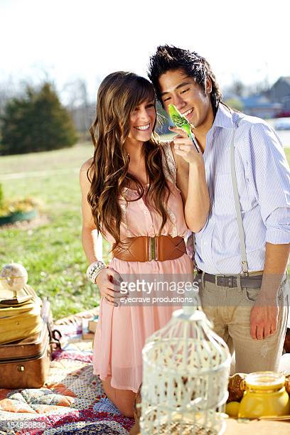 young heterosexual couple picnic happiness
