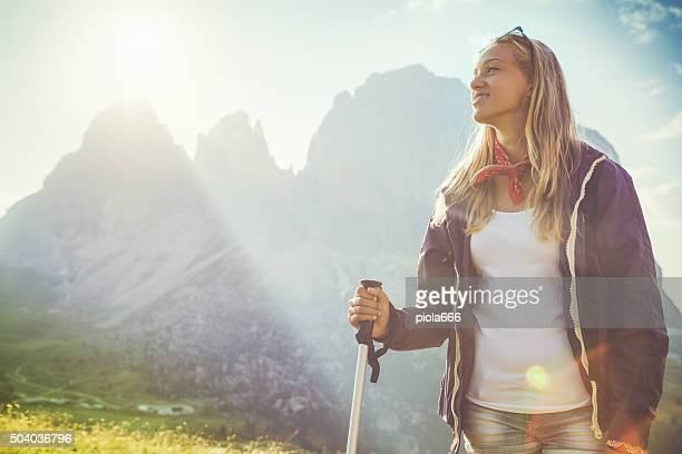 Young hiker girl and the mountain