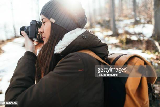 Young hiker photographing nature