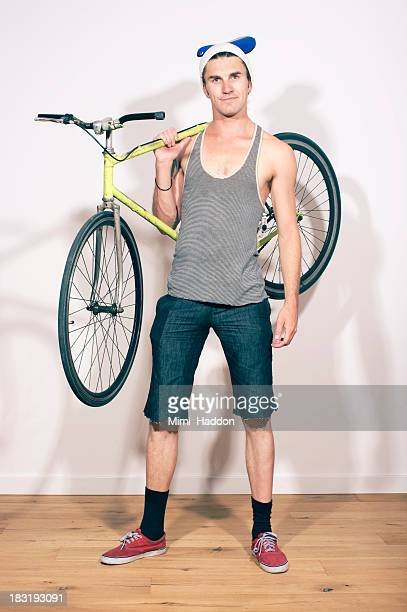 Young Hip Man Carrying Bicycle