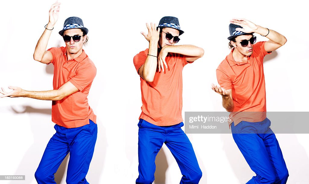 Young Hip Man Dancing on White Background : Stock-Foto