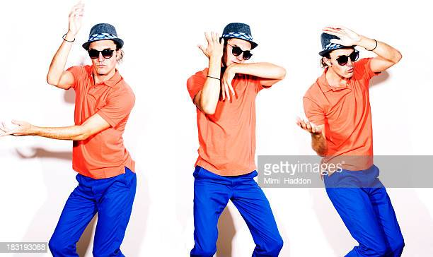 Young Hip Man Dancing on White Background
