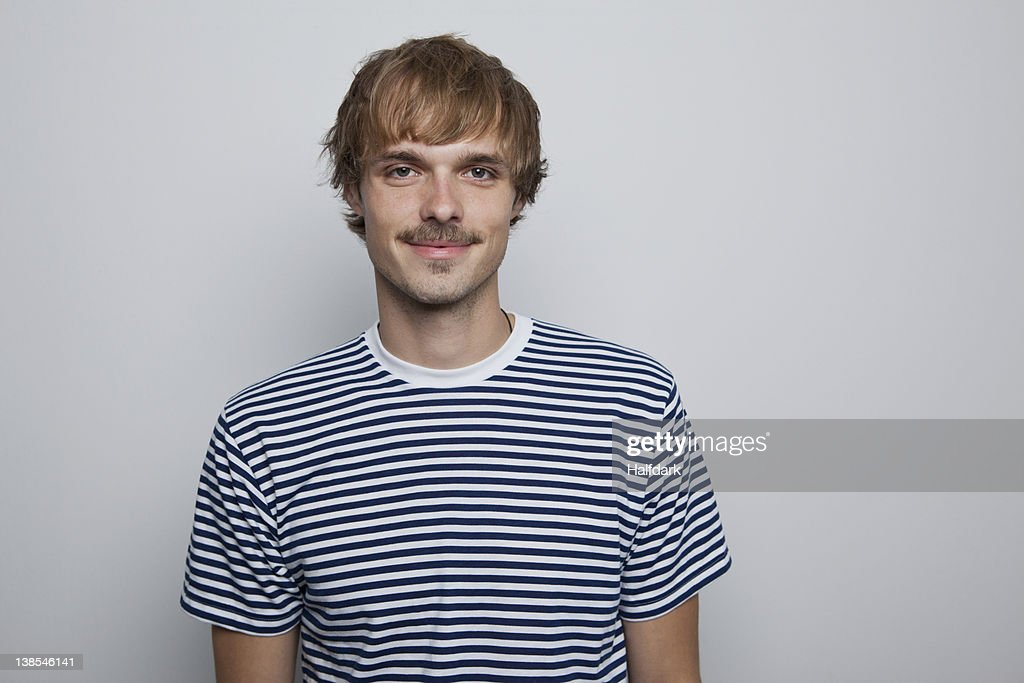 A young, hip man in a striped t-shirt