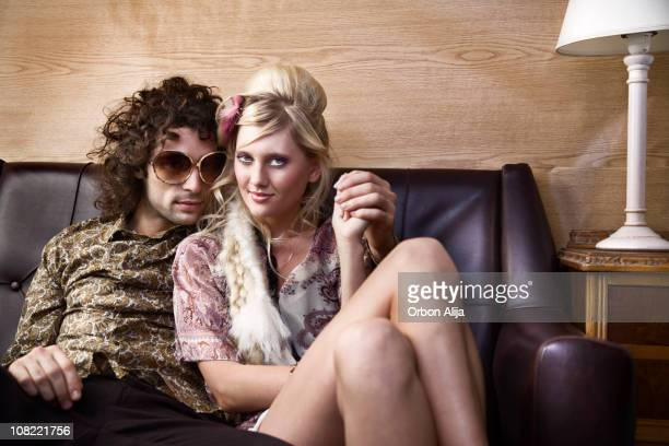 Young Hippie Couple Relaxing on Couch