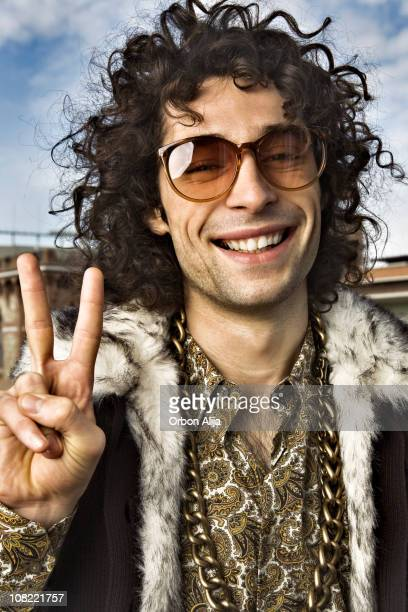 Young Hippie Man Making Peace Sign with Hands