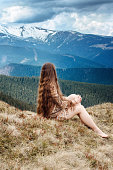 Young hippie girl in snowy mountains
