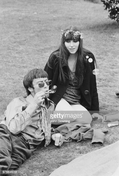 A young hippy couple relaxing in the grounds of Alexandra Palace London after attending the '14 hour Technicolour Dream' a psychedelic concert...