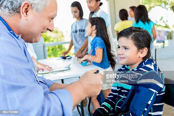 Young hispanic boy getting a health examination