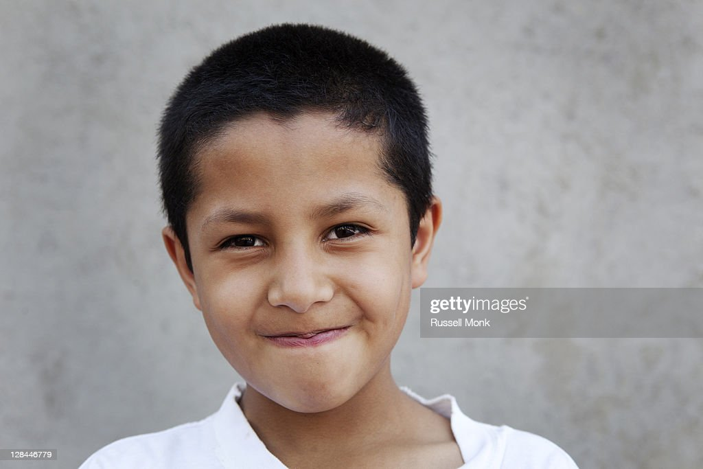 A young Hispanic boy smiling : Stock Photo