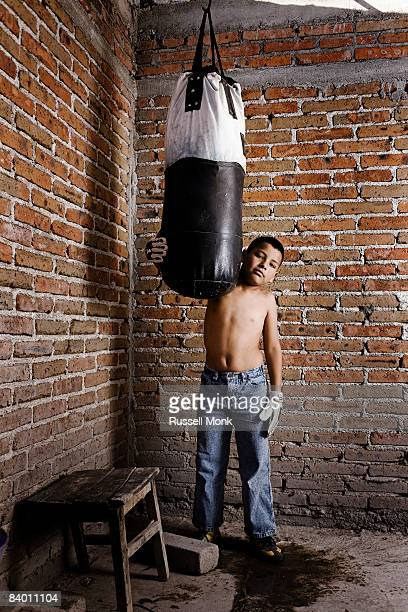 Young Hispanic boy with punch bag