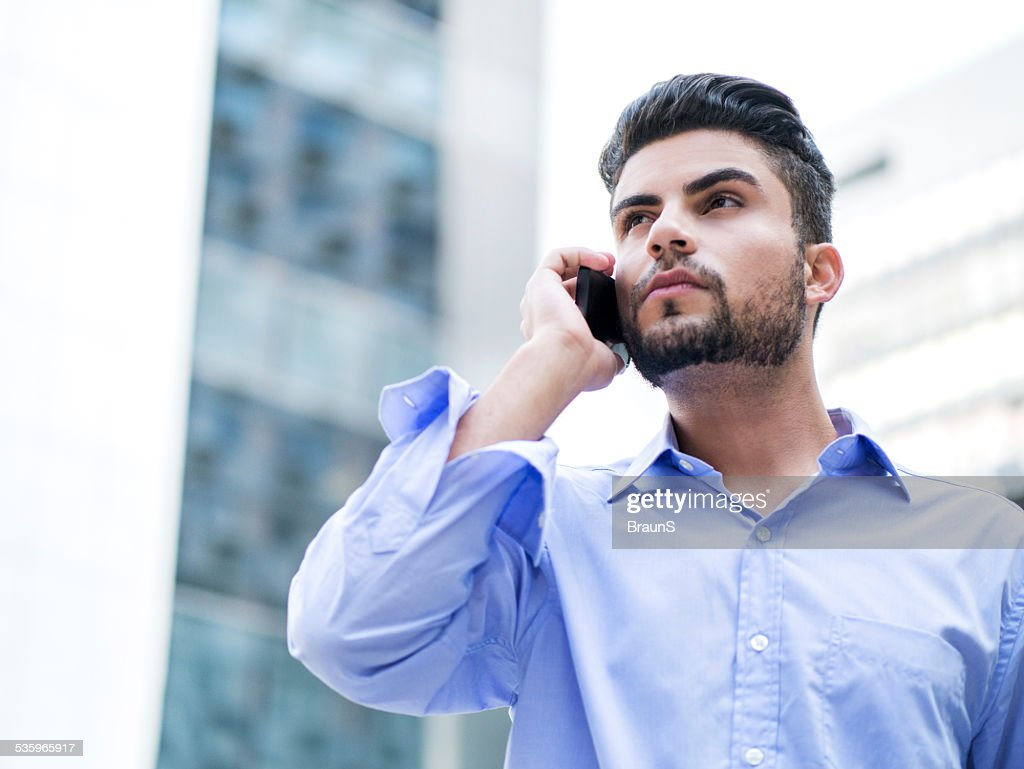 Young Hispanic businessman on the phone. : Stock Photo