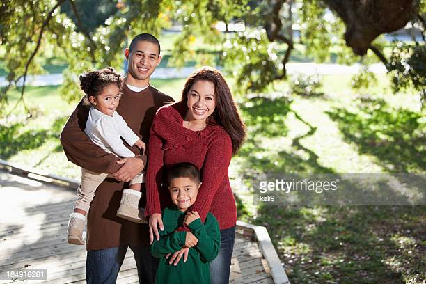Young hispanic family at park