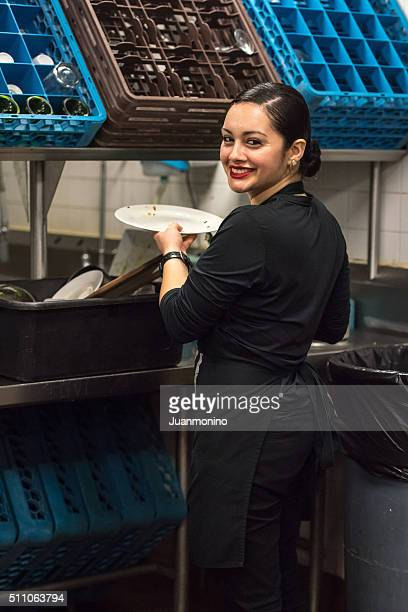 Young hispanic female kitchen worker