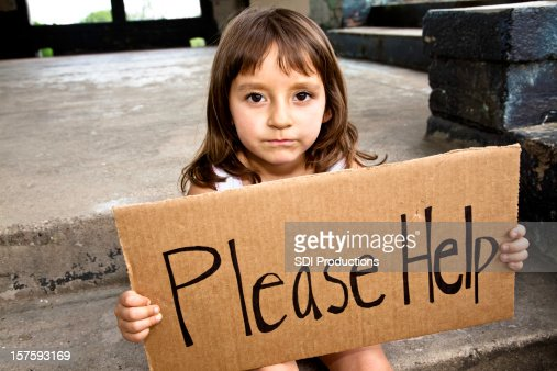 Young Hispanic Girl Holding a Please Help Sign
