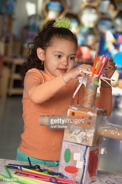 Young Hispanic girl making art project
