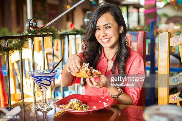Young Hispanic Women At Mexican Restaurant