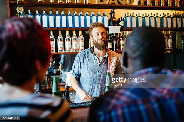 Young Hispter Bartender Talking With Customers