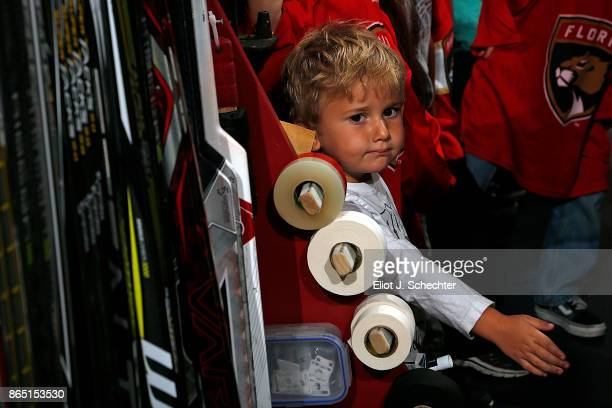 A young hockey fan stands next to the stick rack prior to the Florida Panthers hosting the Pittsburgh Penguins at the BBT Center on October 20 2017...