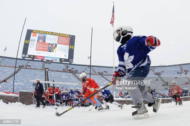 Young hockey fans play in the auxiliary pond during the 2014 Bridgestone NHL Winter Classic on January 1 2014 at Michigan Stadium in Ann Arbor...