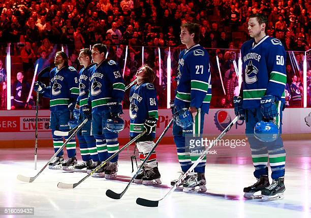 Young hockey player John Mitchell stands with the Vancouver Canucks for the national anthem before their NHL game against the Colorado Avalanche at...