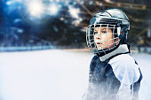 Portrait of  hockey player kid with helmet