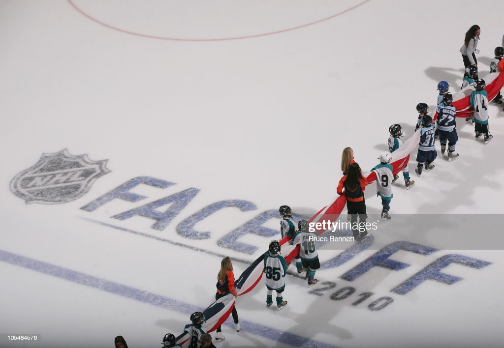 Young hockey players practice carrying the flag prior to the game between the Dallas Stars and the New York Islanders at the Nassau Coliseum on October 9, 2010 in Uniondale, New York.