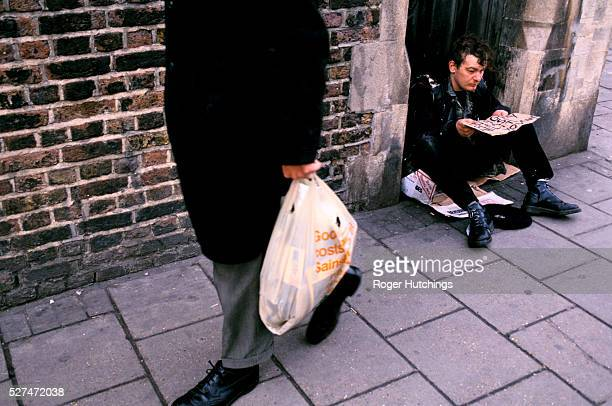 A young homeless man begging outside of Sainsburys supermarket in Camden London