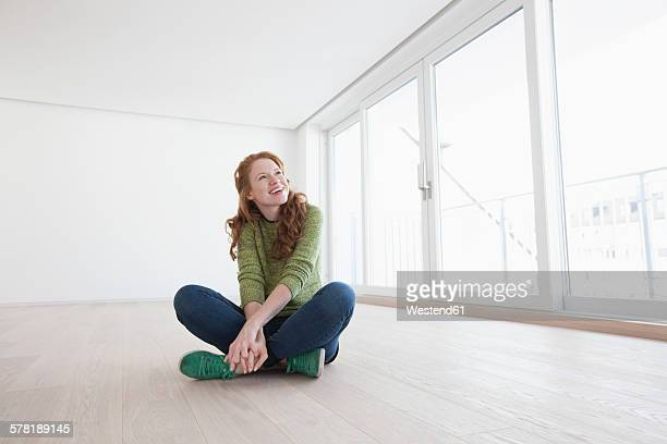 Young house-hunting woman viewing modern flat