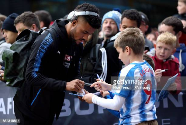 A Young Huddersfield Town fan gets the autograph of Elias Kachunga before the Premier League match at the John Smith's Stadium Huddersfield