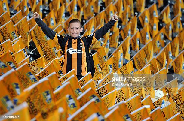 A young Hull City fan is seen amongst flags ahead of the Barclays Premier League match between Hull City and Everton at the KC Stadium on May 11 2014...