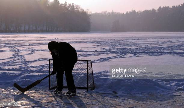 A young icehockey player enjoys a game on a iced pond on January 10 near Benesov some 50Kms far from Prague AFP PHOTO/ MICHAL CIZEK