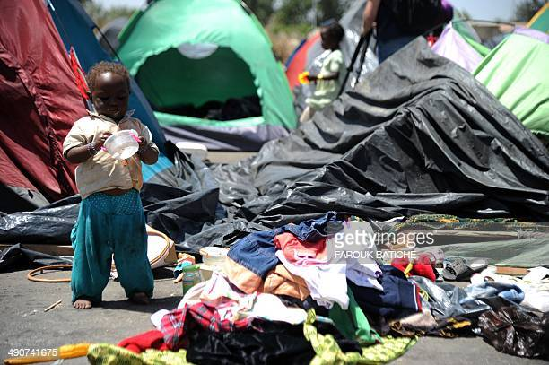 A young illegal migrant from Niger stands next to his tent on May 14 2014 after he and other migrants settled some of them for more than one year...