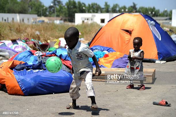 Young illegal migrants from Niger play next to their tents on May 14 2014 after settling with their family and other migrants some of them for more...