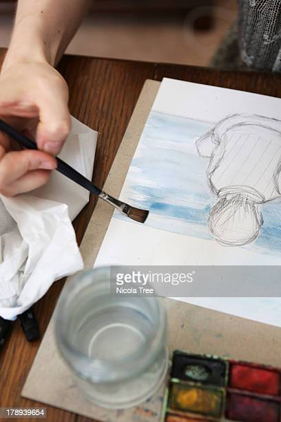 A young illustrator working on an illustration