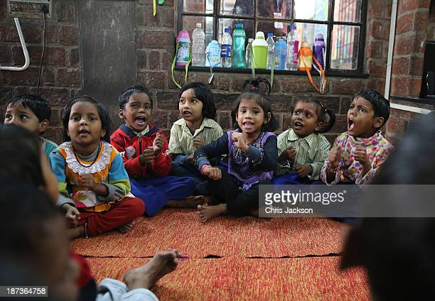 Young India Children in class at Katha Community School in the Govindpuri slum district during day 3 of an official visit to India on November 8 2013...