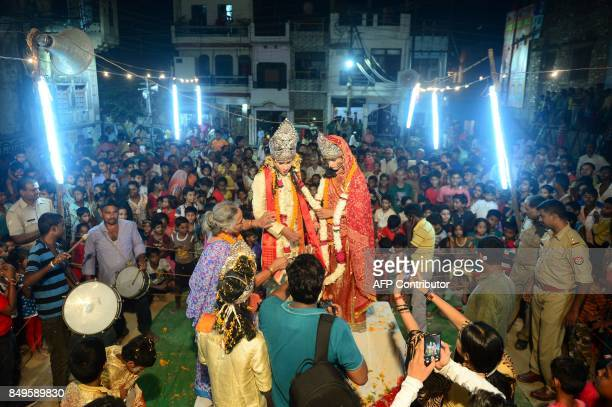 TOPSHOT Young Indian artists dressed as Hindu Gods Rama and Sita perform a traditional Ram Leela drama which narrates the life of Hindu god Rama as...