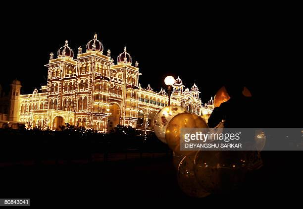 A young Indian balloon vendor waits for customers in front of Mysore palace in the Southern Indian city of Mysore on April 8 2008 The palace was the...