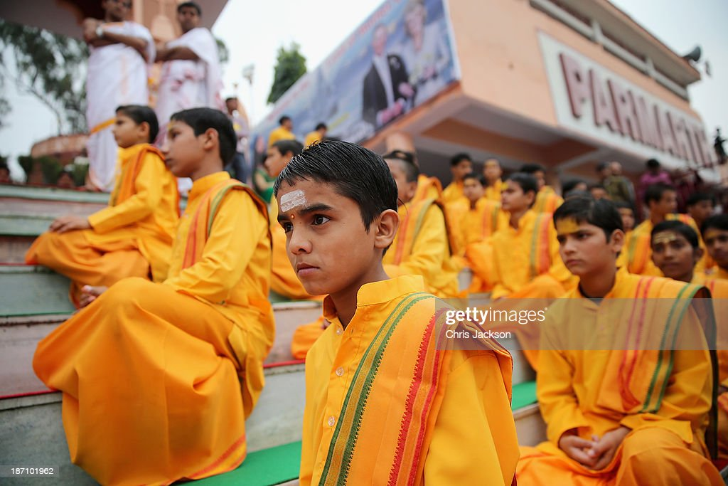 Young Indian boys in traditional dress are seen at the Parmarth Niketan Temple on the banks of the River Ganges during day 1 of an official visit to India on November 6, 2013 in Dehradun, India. This will be the Royal couple's third official visit to India together and their most extensive yet, which will see them spending nine days in India and afterwards visiting Sri Lanka in order to attend the 2013 Commonwealth Heads of Government Meeting.