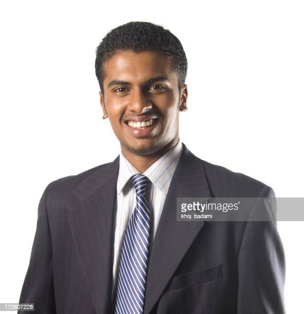 Young Indian businessman smiling in suit