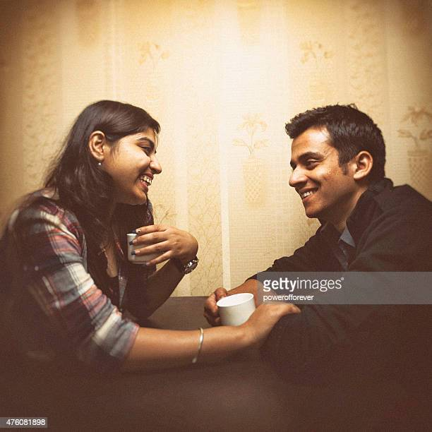 Young Indian couple having coffee in a cafe